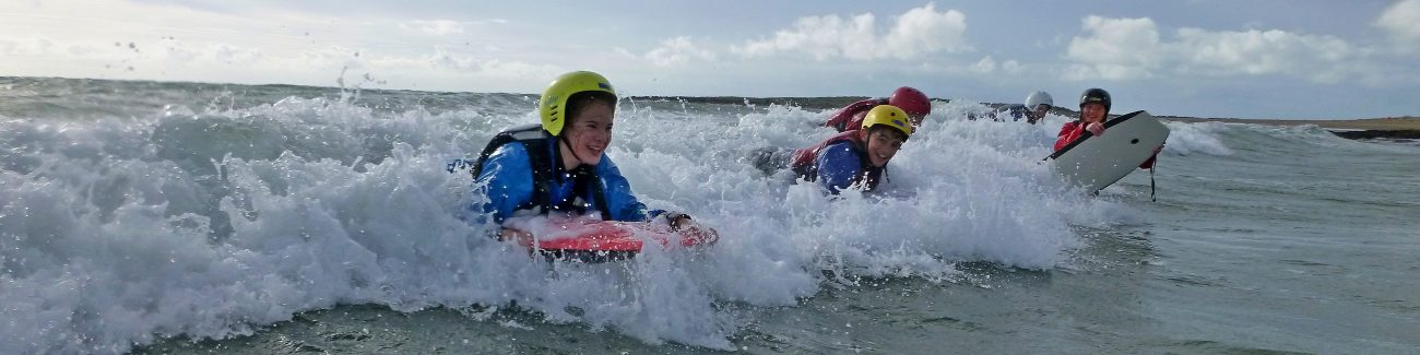 A school group use body boarding as a way of learning through adventure
