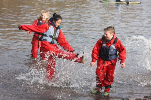 Kicking & splashing water, lake Padarn, school pupils