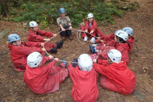 Circle of school group pupils, team building for outdoor education
