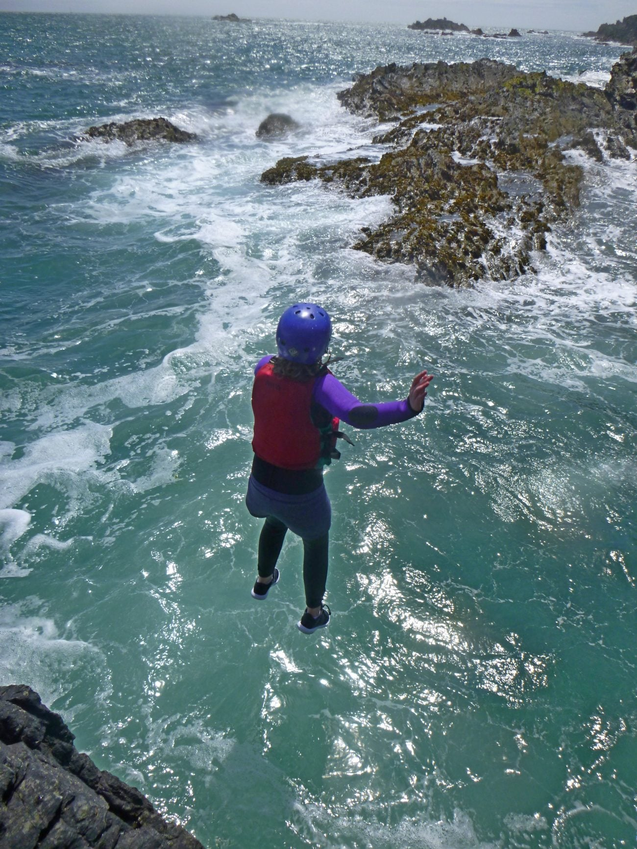 Jump into sea coasteering off sea cliffs, Anglesey North Wales