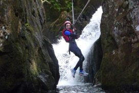 1 student enjoying a Tyrolean / Zip Wire in the Canyon / Gorge about to land in a deep pool of water.