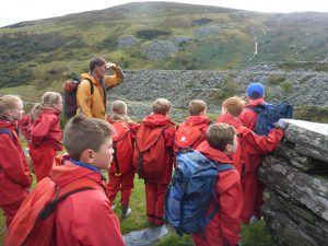 Group of pupils looking towards the mountain.