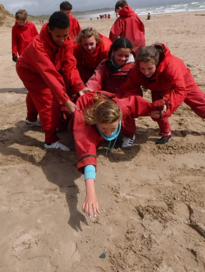 outdoor education on the beach with secondary school pupils