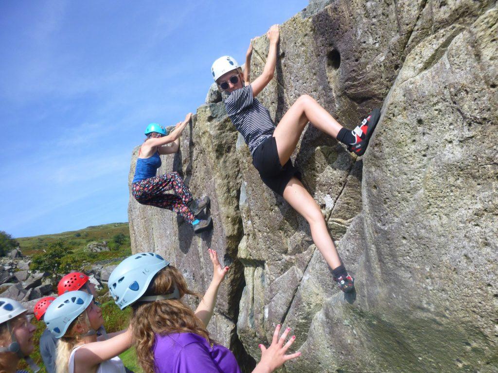 School bouldering on outdoor rock in North Wales