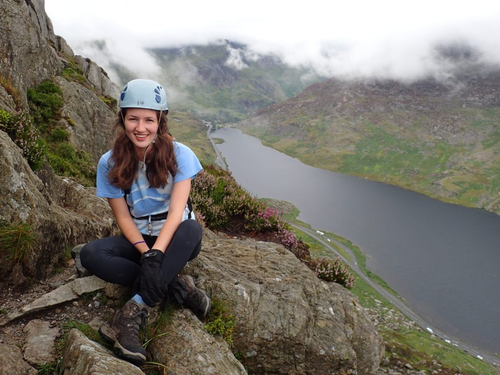resting while mountain walking in Snowdonia with lake view