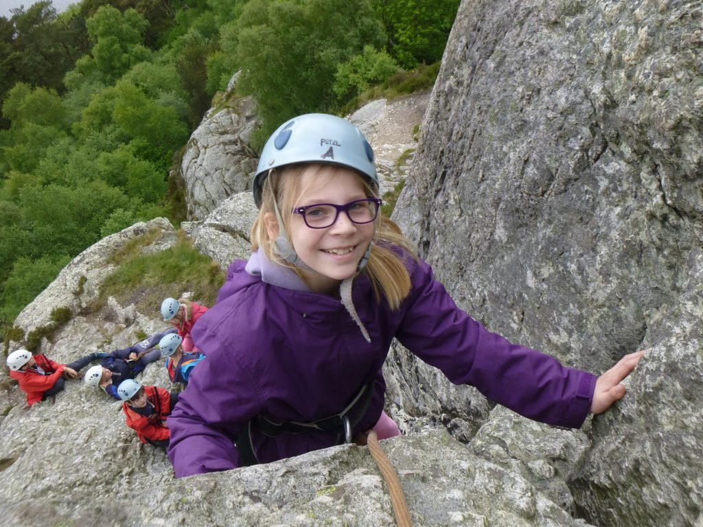 school rock climbing on an outdoor activity course
