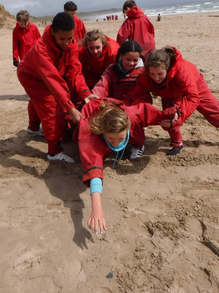outdoor team building on the Welsh beach