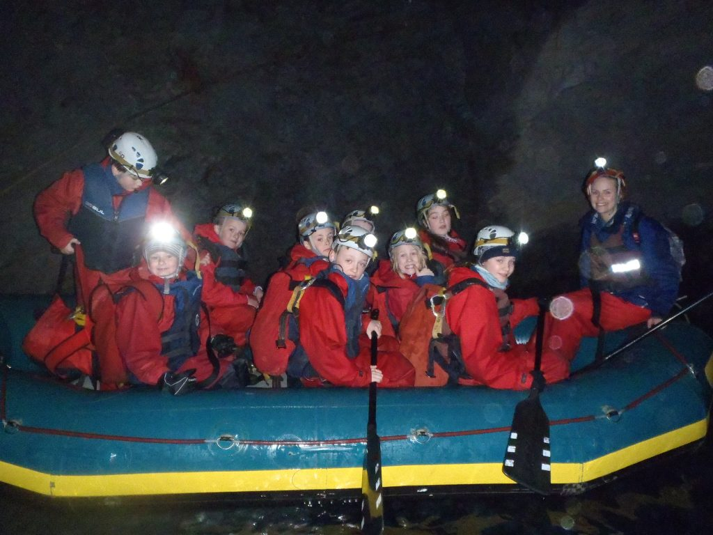 Outdoor education course rafting underground in mine