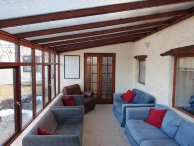 Conservatory seating area in Bryn Eryr Accommodation