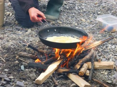 bushcraft firelighting course cooking pancakes outdoors at arete centre, North Wales