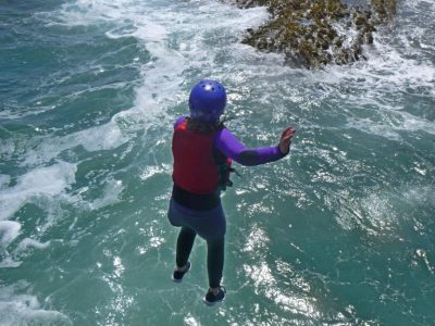 Coasteering jump into sea on school trip