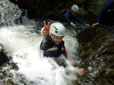 Outdoor activity course in gorge with school pupil