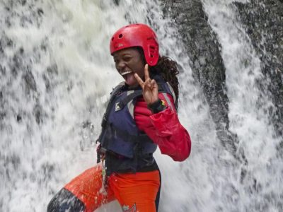 Outdoor gorge scrambling course under waterfall in North Wales